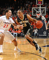 Wake Forest guard Coron Williams (13) drives past Virginia guard London Perrantes (23) during the first half of an NCAA basketball game Wednesday Jan. 08, 2014 in Charlottesville, VA. (Photo/The Daily Progress/Andrew Shurtleff)