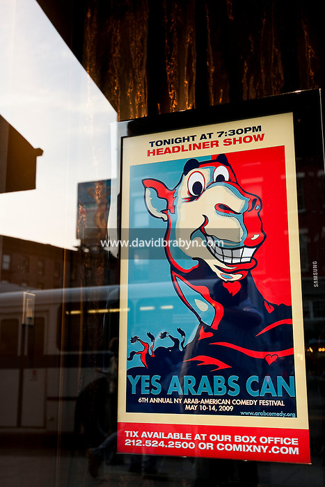 View of the poster of the 6th Annual NY Arab-American Comedy Festival in the window of the exterior of the Comix comedy club in New York, USA, 13 May 2009.