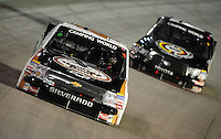 Nov. 20, 2009; Homestead, FL, USA; NASCAR Camping World Truck Series driver Kevin Harvick leads Kyle Busch during the Ford 200 at Homestead Miami Speedway. Mandatory Credit: Mark J. Rebilas-