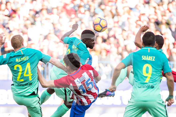 Samuel Umiti of Futbol Club Barcelona competes for the ball with Stefan Savic of Atletico de Madrid  during the match of Spanish La Liga between Atletico de Madrid and Futbol Club Barcelona at Vicente Calderon Stadium in Madrid, Spain. February 26, 2017. (ALTERPHOTOS)