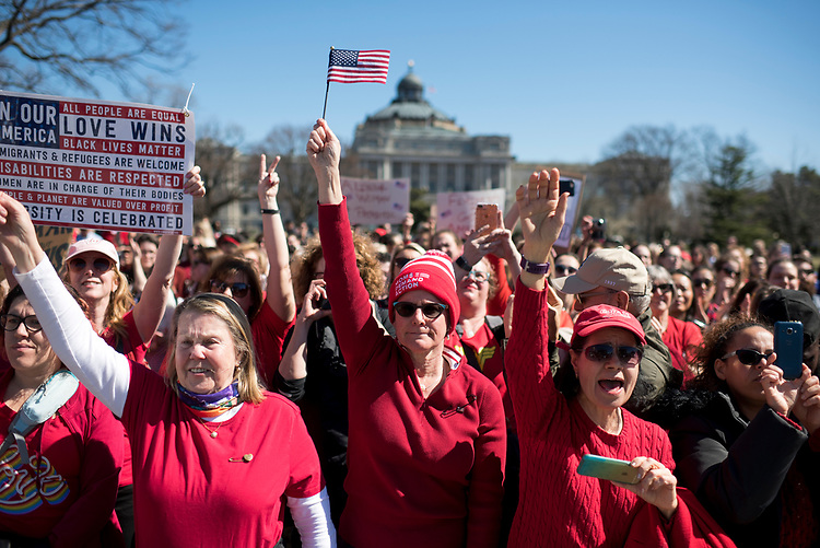 UNITED STATES - MARCH 8: Demonstrators gather of the east lawn of the Capitol for a rally with House Minority Leader Nancy Pelosi, D-Calif., and other Democratic members after they walked out of the House Chamber to support A Day Without A Woman rallies happening across the country, March 8, 2017. The rallies coincides with International Women's Day. (Photo By Tom Williams/CQ Roll Call)