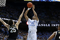 CHAPEL HILL, NC - MARCH 03: Garrison Brooks #15 of the University of North Carolina shoots over Ismael Massoud #25 of Wake Forest University during a game between Wake Forest and North Carolina at Dean E. Smith Center on March 03, 2020 in Chapel Hill, North Carolina.
