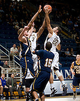 Richard Solomon of California and Harper Kamp of California try to grab a loose ball during the game against San Diego at Haas Pavilion in Berkeley, California on November 1st, 2011.  California defeated San Diego, 88-53.