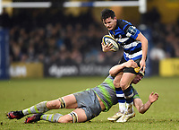 Freddie Burns of Bath Rugby is tackled in possession. Anglo-Welsh Cup match, between Bath Rugby and Newcastle Falcons on January 27, 2018 at the Recreation Ground in Bath, England. Photo by: Patrick Khachfe / Onside Images