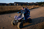 KLEINFONTEIN, SOUTH AFRICA - JULY 15: Residents of the all white Kleinfontein community travels in a quad bike on July 15, 2013 in Kleinfontein outside Pretoria, South Africa. The all white town with about one thousand residents are all Afrikaners with a Vortrekker heritage. Only white Afrikaners who share Afrikaner culture, language and religion are allowed to settle in the town. (Photo by: Per-Anders Pettersson)
