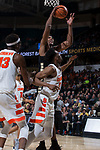Doral Moore (4) of the Wake Forest Demon Deacons grabs an offensive rebound during second half action against the Syracuse Orange at the LJVM Coliseum on January 3, 2018 in Winston-Salem, North Carolina.  The Demon Deacons defeated the Orange 73-67.  (Brian Westerholt/Sports On Film)