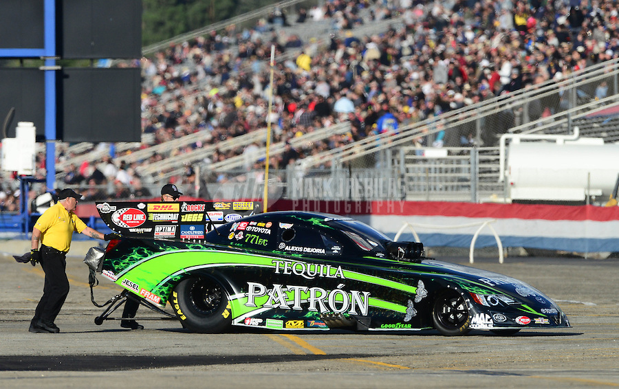 Nov. 9, 2012; Pomona, CA, USA: NHRA funny car driver Alexis DeJoria during qualifying for the Auto Club Finals at at Auto Club Raceway at Pomona. Mandatory Credit: Mark J. Rebilas-
