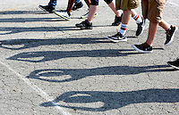 NWA Democrat-Gazette/DAVID GOTTSCHALK  Shadows are cast by members of the Greenland High School band marching at attention during practice Thursday, August 6, 2015 at the school. The 42 member band under the direction of Jeremy Doss is preparing the fall pep rallies, football half time performances and competitions taking place this fall.