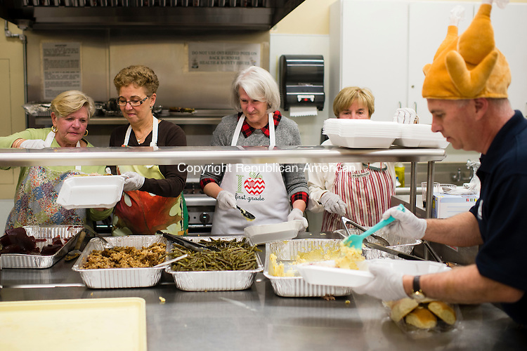 MIDDLEBURY, CT- 18 November 2015-111815EC01-  from L to R: Joan Sullivan, Sandy Allen, Joann Kloss, Heidi Shea and Scott Pellman work in an assembly line to prepare food in to go containers Wednesday night. The Lion's Club prepared meals for 200 people during its annual turkey dinner Wednesday night at the Shepardson Community Center in Middlebury. Visitors received a traditional Thanksgiving meal with turkey, stuffing, mashed potatoes, green beans and pumpkin pie. Money raised benefits the Middlebury Family Services Emergency Fund and other community outreach programs. Erin Covey Republican-American
