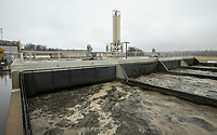 NWA Democrat-Gazette/BEN GOFF @NWABENGOFF<br /> Wastewater churns through Thursday, Nov. 21, 2019, in one of the biological nutrient reduction trains at the Rogers wastewater treatment plant. The new solid storage silo is under construction in the background.