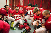 The Greeley County High School football team, the Tribune Jackrabbits, hold a team prayer for an eight man football game in Tribune, Kansas, Friday, October 13, 2013. The challenges of depopulation in the rural Midwest and Great Plains continue to grow as counties increasingly see more deaths than births. Greeley County, Kansas's least populated county, and the state as a whole are mounting a new fight to stem losses and finding early success. <br /> <br /> Photo by Matt Nager
