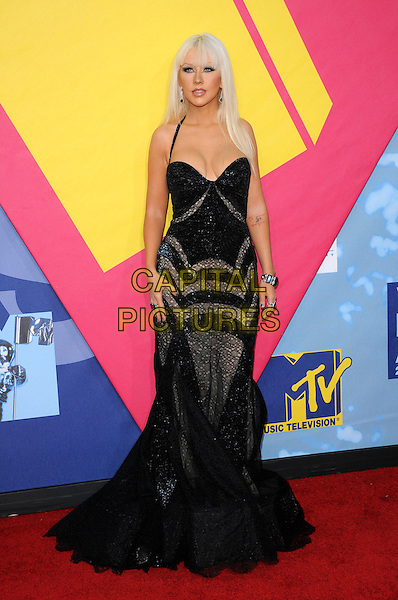 CHRISTINA AGUILERA .The 2008 MTV Video Music Awards held at Paramount Studios in Hollywood, California, USA..September 7th, 2008.VMA Vmas full length straight hair fringe bangs black halterneck dress beaded silver grey gray long maxi fishtail .CAP/DVS.©Debbie VanStory/Capital Pictures.