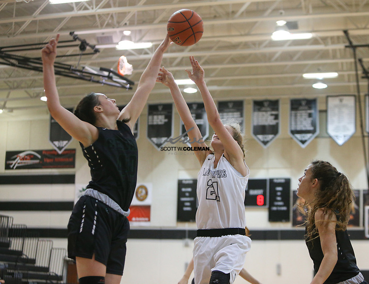 Cedar Park Timberwolves post Nicole Leff (40) blocks a shot by Vandegrift Vipers forward Jane Stevens (21) during a girls high school basketball game between the Vandegrift Vipers and the Cedar Park Timberwolves at Vandegrift High School in Austin, Texas on November 14, 2017.