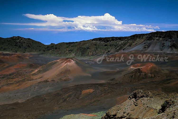 An artistic cloud formation above the crater in HALEAKALA NATIONAL PARK on Maui in Hawaii