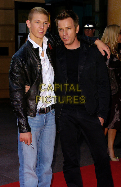 "ALEX PETTYFER & EWAN McGREGOR.The ""Stormbreaker"" world premiere at Vue West End, London, UK..July 17th, 2006.Ref: CAN.half length black leather jacket suit arm over shoulder .www.capitalpictures.com.sales@capitalpictures.com.©Capital Pictures"