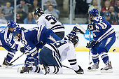 Sean Bertsch (Air Force - 15), Kenny Agostino (Yale - 18), Scott Kozlak (Air Force - 8) - The Yale University Bulldogs defeated the Air Force Academy Falcons 2-1 (OT) in their East Regional Semi-Final matchup on Friday, March 25, 2011, at Webster Bank Arena at Harbor Yard in Bridgeport, Connecticut.
