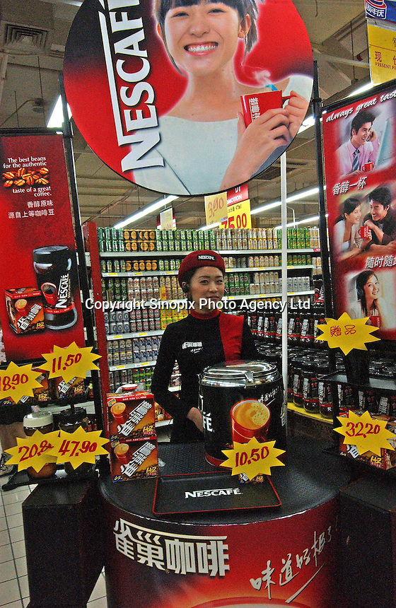 A Nescafe coffee promotion in Carrefour supermarket in Guangzhou, China. Nestle's Nescafe brand is the dominant brand in China and as the traditional tea drinking culture changes it's slaes are likely to continue to grow. Coffee sales in China were worth more than 90 million US dollars in 2002, but the country accounts for just one percent of world consumption..07 May 2005