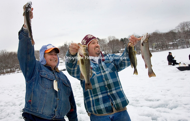 PLYMOUTH, CT. 16 February 2013-021613SV03-From left, Rich Caisse of Terryville and Jim Roland of Plymouth hold up some of the fish they caught during the Terryville Fish & Game's ice fishing derby at Middle Pond on Grove Street in Terryville Saturday..Steven Valenti Republican-American