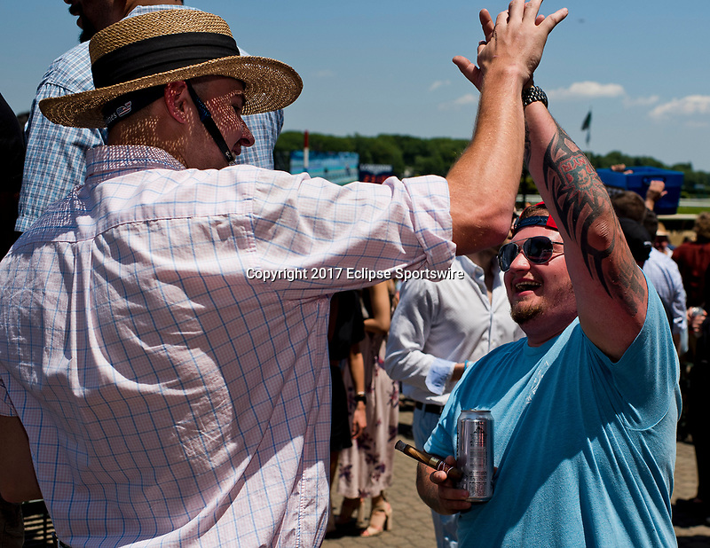 ELMONT, NY - JUNE 10: Two fans share a high-five on Belmont Stakes Day at Belmont Park on June 10, 2017 in Elmont, New York (Photo by Scott Serio/Eclipse Sportswire/Getty Images)