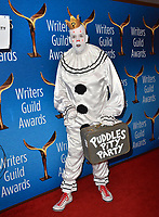 LOS ANGELES, CA. February 17, 2019:  Puddles Pity Party & Mike Geier at the 2019 Writers Guild Awards at the Beverly Hilton Hotel.<br /> Picture: Paul Smith/Featureflash