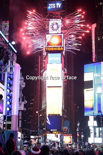 New York, NY-December 31: Atmosphere at the 2014 New Years Eve Celebration held in Times Square on December 31, 2013 in New York City.<br />