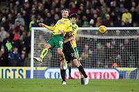 Tom Trybull of Norwich City beats Steve Morison of Millwall to the aerial ball during Norwich City vs Millwall, Sky Bet EFL Championship Football at Carrow Road on 1st January 2018