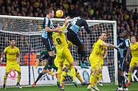 Garry Thompson of Wycombe Wanderers & Aaron Pierre of Wycombe Wanderers go up for a corner during the Sky Bet League 2 match between Wycombe Wanderers and Oxford United at Adams Park, High Wycombe, England on 19 December 2015. Photo by Andy Rowland.