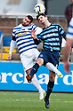 Morton's Peter MacDonald and Forfar's Stuart Malcolm challenge for the ball.