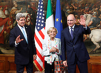 Il Presidente del Consiglio Enrico Letta, destra, ed il Ministro degli Esteri Emma Bonino accolgono il Segretario di Stato degli Stati Uniti John Kerry, sinistra, a Palazzo Chigi, Roma, 23 ottobre 2013.<br /> Italian Premier Enrico Letta, right, and Italian Foreign Minister Emma Bonino welcome U.S. Secretary of State John Kerry, left, at Chigi Palace, Rome, 23 October 2013.<br /> UPDATE IMAGES PRESS/Isabella Bonotto