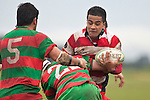 Reynold Leelo has Sam Cole & Dominic Olson to contend with. Counties Manukau Premier Club Rugby game between Waiuku & Karaka played at Waiuku on Saturday July 4th 2009. Waiuku won the game 22 - 7.