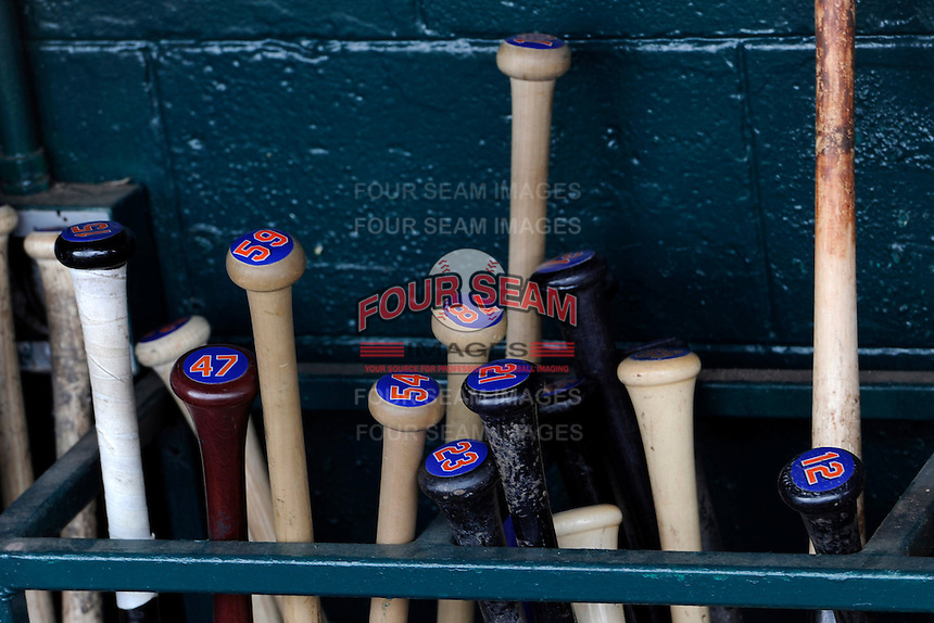 New York Mets bats in the dugout before a Spring Training game against the Detroit Tigers at Joker Marchant Stadium on March 11, 2013 in Lakeland, Florida.  New York defeated Detroit 11-0.  (Mike Janes/Four Seam Images)