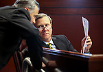 Nevada Senate Republicans James Settelmeyer and Greg Browere work on the Senate floor at the Legislative Building in Carson City, Nev., on Thursday, April 9, 2015. <br /> Photo by Cathleen Allison