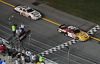 Jul. 4, 2008; Daytona Beach, FL, USA; Nascar Nationwide Series driver Denny Hamlin (20) takes the checkered flag ahead of teammate Kyle Busch (18) to win the Winn-Dixie 250 at Daytona International Speedway. Mandatory Credit: Mark J. Rebilas-