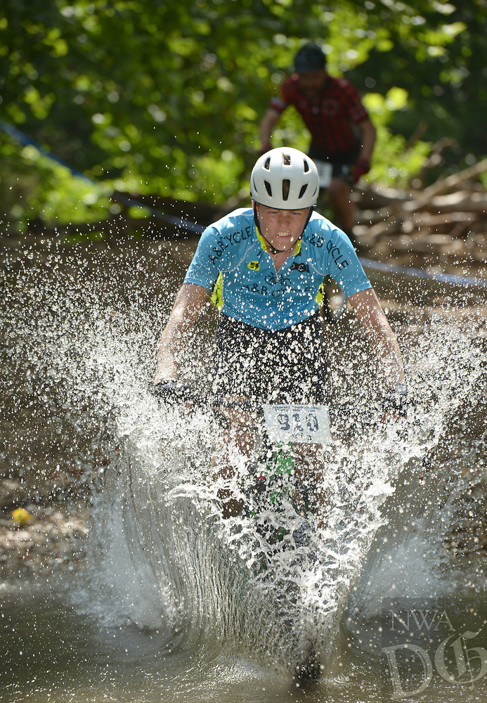 NWA Democrat-Gazette/BEN GOFF @NWABENGOFF<br /> Owen Fabro, a category 3 racer from Springfield, Mo., fords a creek Sunday, July 16, 2017, during cross country races on the final day of the 19th annual Fat Tire Festival at Lake Leatherwood City Park in Eureka Springs.