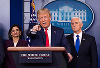 United States President Donald J. Trump delivers remarks on the COVID-19 (Coronavirus) pandemic alongside members of the Coronavirus Task Force in the Brady Press Briefing Room at the White House in Washington, DC on Wednesday, March 18, 2020.  At left is Seema Verma, Administrator, Centers for Medicare and Medicaid Services and at right is US Vice President Mike Pence.<br /> Credit: Kevin Dietsch / Pool via CNP/AdMedia