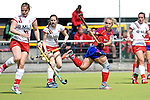 Mannheim, Germany, April 18: During the 1. Bundesliga Damen match between TSV Mannheim (white) and Mannheimer HC (red) on April 18, 2015 at TSV Mannheim in Mannheim, Germany. Final score 1-7 (1-4). (Photo by Dirk Markgraf / www.265-images.com) *** Local caption *** (l-r) Viktoria Przybilla #15 of TSV Mannheim, Yasemine Zorke #28 of TSV Mannheim, Lydia Haase #12 of Mannheimer HC, Tonja Fabig #31 of TSV Mannheim