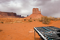 Navajo jewelry stands for sale along a stop on the park road at the Monument Valley Navajo Tribal Park in southern Utah, Friday, March 10, 2006. The stunning vistas in the park, stars in many John Ford westerns, are an often-forgotten destination for American travelers. (Kevin Moloney for the New York Times)