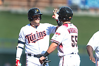 Salt River Rafters second baseman Travis Blankenhorn (5), of the Minnesota Twins organization, congratulates Dom Miroglio (55), of the Arizona Diamondbacks organization, during an Arizona Fall League game against the Surprise Saguaros at Salt River Fields at Talking Stick on October 23, 2018 in Scottsdale, Arizona. Salt River defeated Surprise 7-5 . (Zachary Lucy/Four Seam Images)