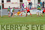 Valentia keeper Brian O'Connor gets low to deny Tarbert's Donal Leahy an almost certain chance of a goal.