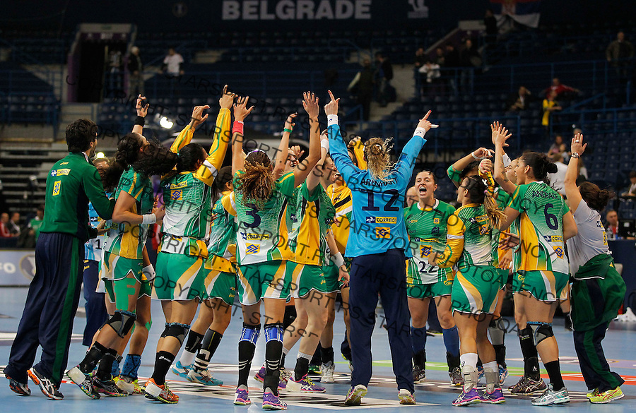 BELGRADE, SERBIA - DECEMBER 18:   Plyers of Brazil celebrate victory against Hungary after the 2013 World Women's Handball Championship 2013 match between Brazil v Hungary at Kombank Arena Hall on December 18, 2013 in Belgrade, Serbia. (Photo by Srdjan Stevanovic/Getty Images)