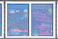*We love Iditarod Mushers* sign painted on school window welcoming mushers at Shageluk checkpoint