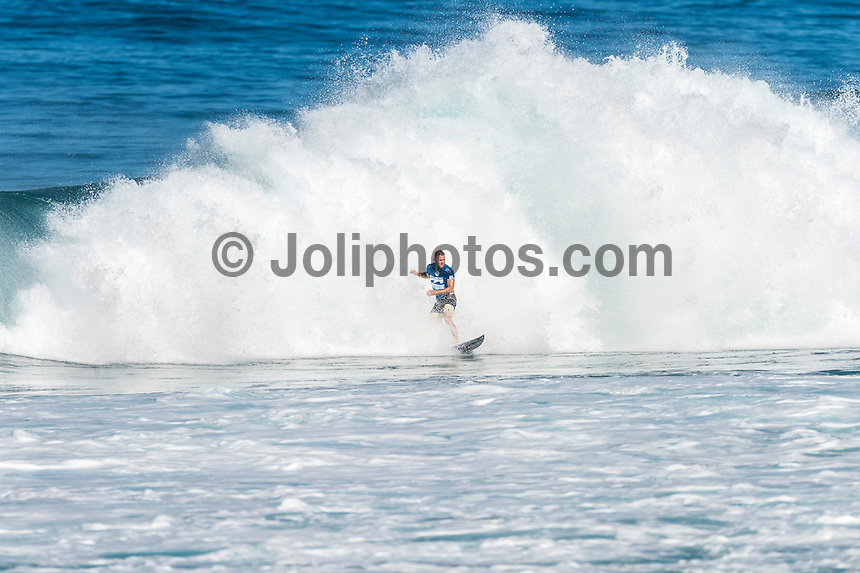 BANZAI PIPELINE, Oahu/Hawaii (Friday, December 12, 2014) Dusty Payne (HAW) .- The final stop of the 2014  World Championship Tour, the Billabong Pipe Masters in Memory of Andy Irons, was  called ON today in double overhead surf. <br /> <br /> Competition began with the final of Men's Pipe Masters Invitational. It had been a 32-man event comprising of local Pipe specialists competing for a US$100,000 prize purse as well as two wildcard positions in the Billabong Pipe Masters. <br /> Reef MacIntosh (HAW) and Makai McNamara (HAW) who moved into the main event.<br /> IN the World Title showdown both Mick Fanning (AUS) and Gabriel Medina (BRA) won their heats today  and moved straight into Round 3 while Kelly Slater (USA) lost his heat and will have to surf in the sudden death Round 2.<br /> The Billabong Pipe Masters in Memory of Andy Irons will determine this year&rsquo;s world surfing champion as well as those who qualify for the elite tour in 2015. As the third and final stop on the Vans Triple Crown of Surfing Series  the event will also determine the winner of the revered three-event leg.<br /> <br /> The ASP Heritage Series, which celebrates the rich culture and history of professional surfing, had it's third and final competitive event of the season today with a four-man heat between Gary Elkerton (AUS), Tom Carroll (AUS), Derek Ho (HAW) and Sunny Garcia (HAW). Carroll dominated the final with Garcia in 2nd , Ho  3rd and Elekerton 4th.<br /> <br /> The world&rsquo;s best female surfers also competed at Pipeline this afternoon in the Women&rsquo;s Pipe Masters Invitational with reigning six-time  Women&rsquo;s World Champion Stephanie Gilmore (AUS) finished in 4th while two-time Women&rsquo;s World Champion Carissa Moore (HAW) easily won the heat., Australian powerhouse Tyler Wright (AUS) was 2nd and international icon Bethany Hamilton (HAW)  finished 3rd. Photo: joliphotos.com