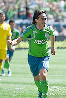 Seattle Sounders FC midfielder Mauro Rosales (10) celebrates after scoring a goal on a penalty kick in a match against Columbus Crew at CenturyLink Field in Seattle, Washington.