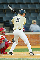 Evan Stephens (5) of the Wake Forest Demon Deacons at bat against the North Carolina State Wolfpack at Wake Forest Baseball Park on March 15, 2013 in Winston-Salem, North Carolina.  The Wolfpack defeated the Demon Deacons 12-6.  (Brian Westerholt/Four Seam Images)