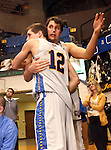 BROOKINGS, SD - MARCH 1:  Seniors Brayden Carlson #12 and Jordan Dykstra #42 from South Dakota State University embrace late in their game against the University of South Dakota Saturday afternoon at Frost Arena in Brookings. (Photo by Dave Eggen/Inertia)