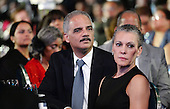 United States Attorney General Eric Holder (L) and his wife, Sharon Malone (R) attend the Congressional Black Caucus Foundation Annual Phoenix Awards dinner at the Walter E. Washington Convention Center, September 27, 2014 in Washington, DC. The CBC's annual conference brings together activists, politicians and business leaders to discuss public policy impacting Black communities in America and abroad. <br /> Credit: Olivier Douliery / Pool via CNP