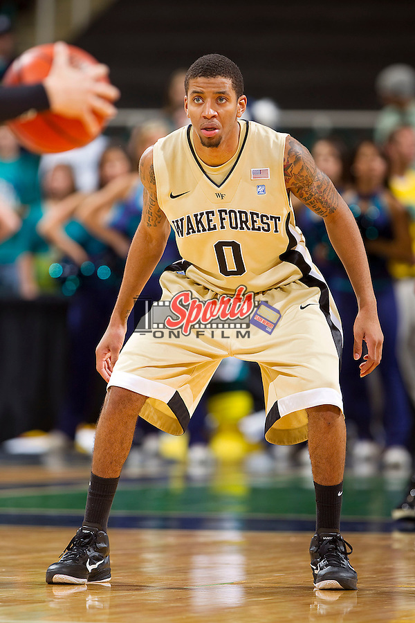 J.T. Terrell #0 of the Wake Forest Demon Deacons on defense against the UNC-Wilmington Seahawks at the Greensboro Coliseum on December 12, 2010 in Greensboro, North Carolina.  The Seahawks defeated the Demon Deacons 81-69. Photo by Brian Westerholt / Sports On Film