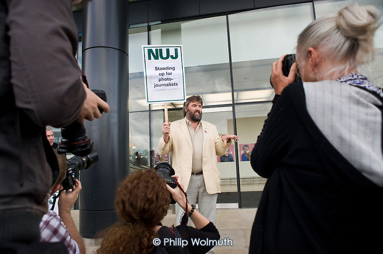 Freelance cartoonist Steve Bell supports an NUJ protest outside the offices of  Guardian News & Media against the company's plans to stop paying freelance photographers for re-use of their pictures.