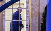 United States President Donald J. Trump enters the Oval Office of the White House after arriving back on Marine One in Washington, DC, USA, 05 March 2017. Trump returned to Washington from a weekend at his Palm Beach. Florida, Mar-a-Lago club.<br /> Credit: Erik S. Lesser / Pool via CNP
