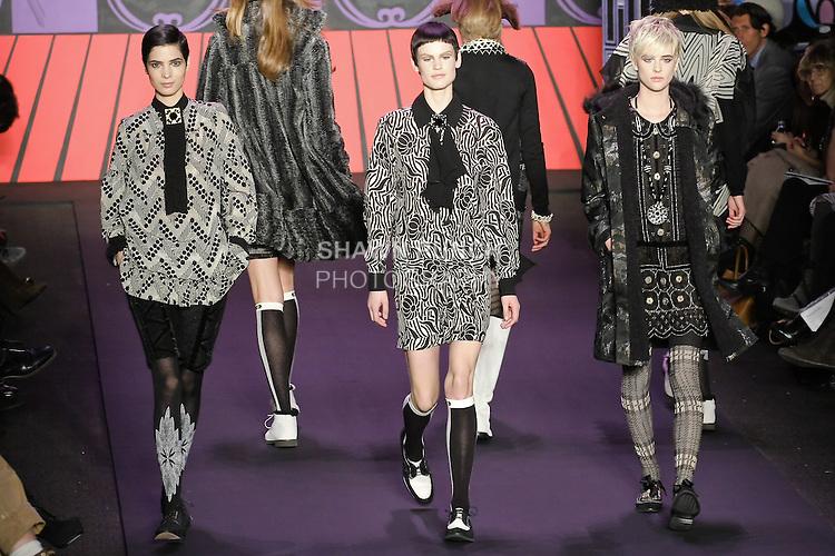 Hanaa ben Abdesslem, Saskia de Brauw, and Milou van Groesen, walk the runway in outfits from the Anna Sui Fall 2011 collection, during Mercedes-Benz Fashion Week Fall 2011.